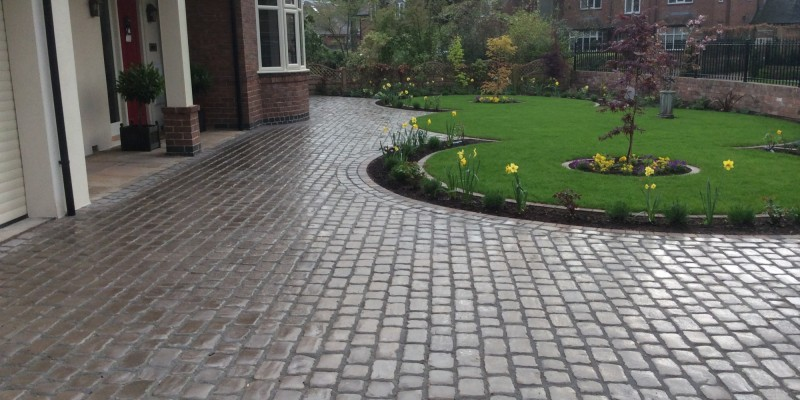 New lawn and design and Drivesys original cobble front driveway
