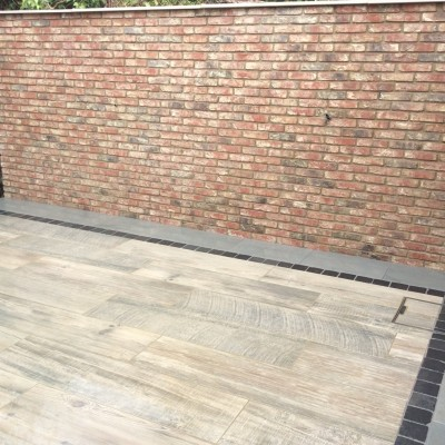 Symphony Vetrified Plank Paving with Black Setts and Bullnose Steps