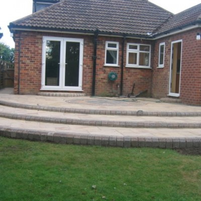 Curved Steps Sweeping up to Indian Stone Patio
