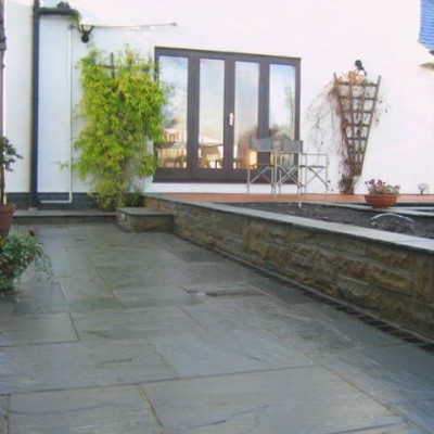 Cedar Wood Decking with 2-Tier Pond and Kandela Grey Paving